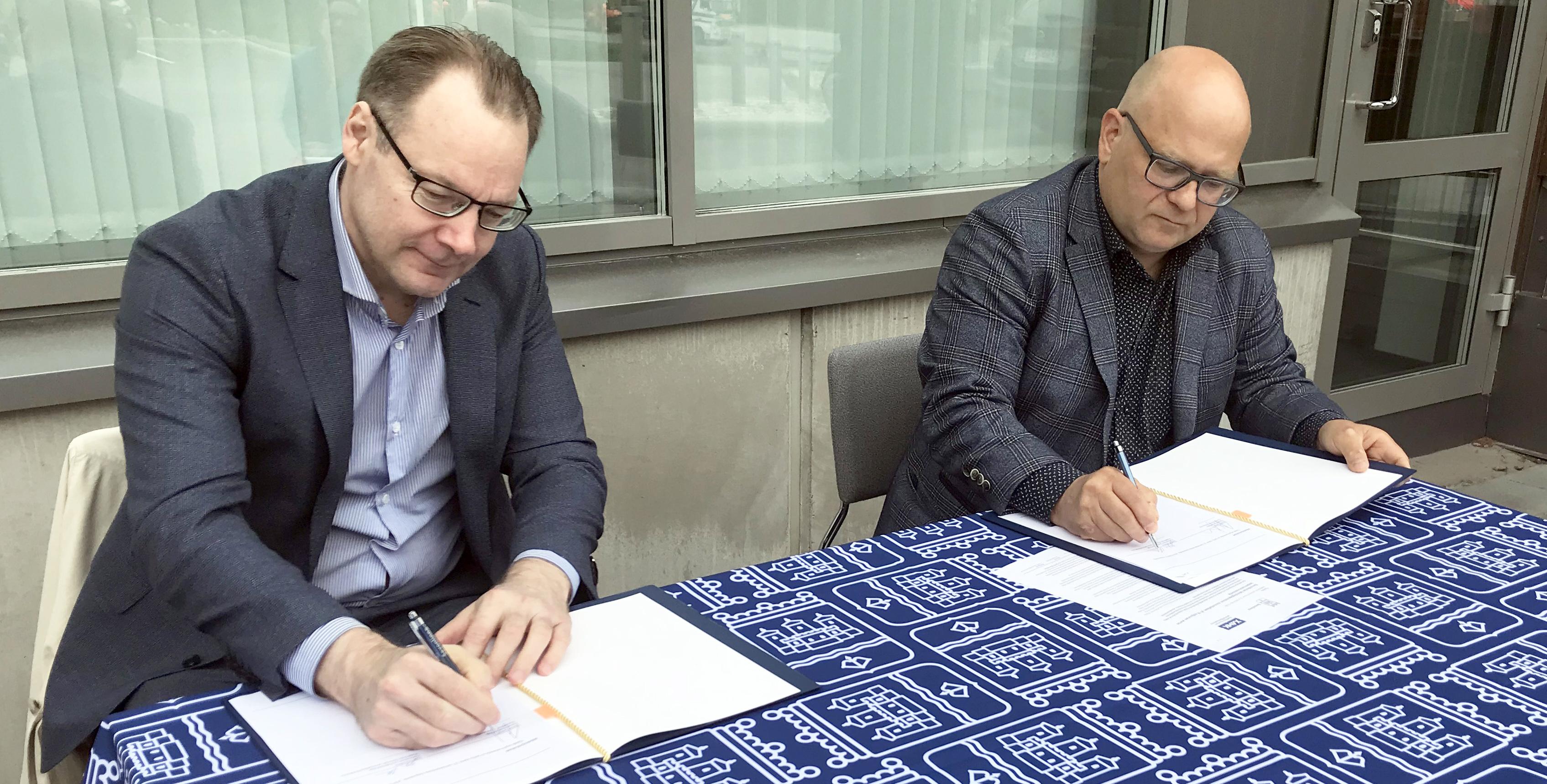 Aiesopimuksen allekirjoitustilaisuus